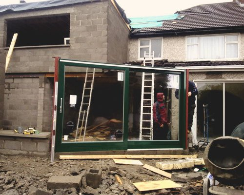 Photo of Aspect Joinery putting in a patio door into a new build